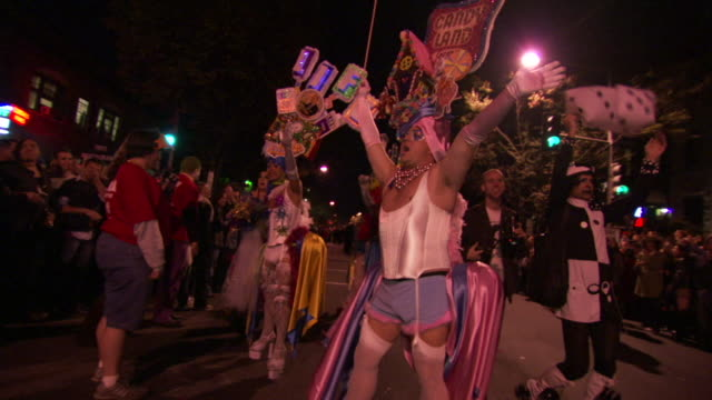 MS PAN Shot of men in drag costumes waving and poses during high heel race in DuPont Circle / Washington, Dist. of Columbia, United States