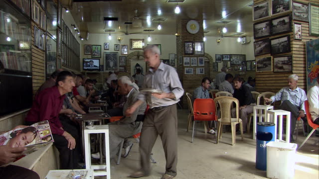 ms shot of men playing back gammon tradtional tea house / sulaymaniyah, kurdistan, iraq  - iraq stock videos & royalty-free footage