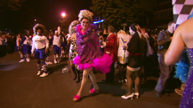 WS POV Shot of men's in drag costumes strut and pose during high heel race in DuPont Circle / Washington, Dist. of Columbia, United States