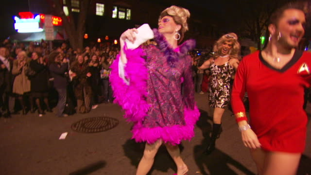 ms pov shot of men's in drag costumes strut and waving to crowd during high heel race in dupont circle / washington, dist. of columbia, united states - drag queen stock videos and b-roll footage