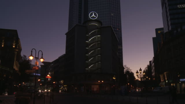 ms shot of mercedes benz office building at night / frankfurt am main, hesse, germany - mercedes benz stock videos and b-roll footage