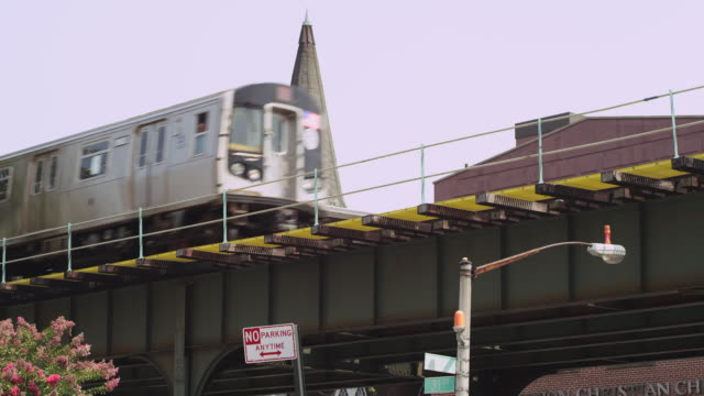 cu pan shot of metro train passes left to right / new york, united states - no parking sign stock videos & royalty-free footage