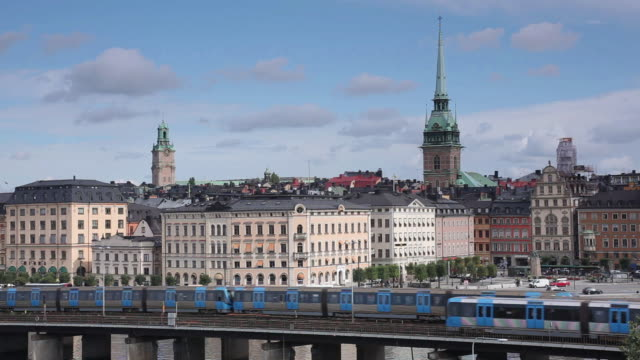 ws shot of metro trains and old town / stockholm, stockholm, sweden - stockholm stock videos & royalty-free footage
