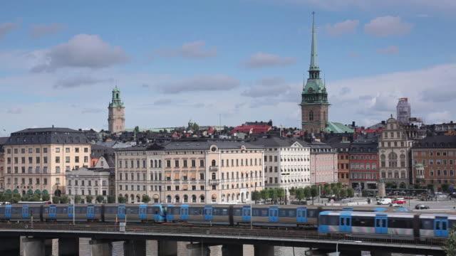 ws shot of metro trains and old town / stockholm, stockholm, sweden - stockholm bildbanksvideor och videomaterial från bakom kulisserna