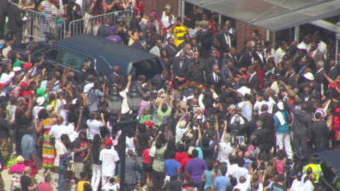ms aerial shot of michael browns casket is loaded into hearse and al sharpton and jesse jackson hug family and friends outside friendly temple missionary baptist church / st louis, missouri, united states - death stock videos & royalty-free footage