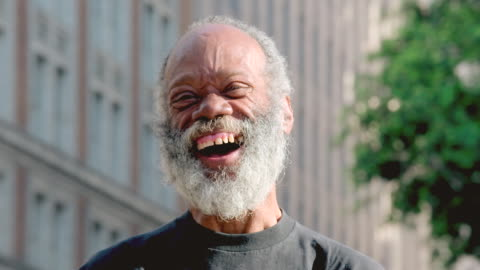 cu shot of middle aged bearded man smiling, then laughing hard and genuinely and his eyes are wise and joyful / los angeles, california, united states - grey hair stock videos & royalty-free footage