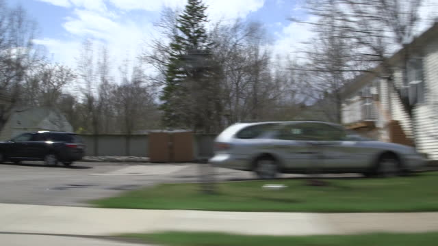 ms pov shot of middle class suburban neighborhood / detroit, michigan, united states - michigan stock videos & royalty-free footage