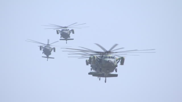 shot of military helicopters flying for military exercise in the air - military helicopter stock videos and b-roll footage