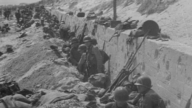 ms shot of military news reel footage at war - schützengraben stock-videos und b-roll-filmmaterial