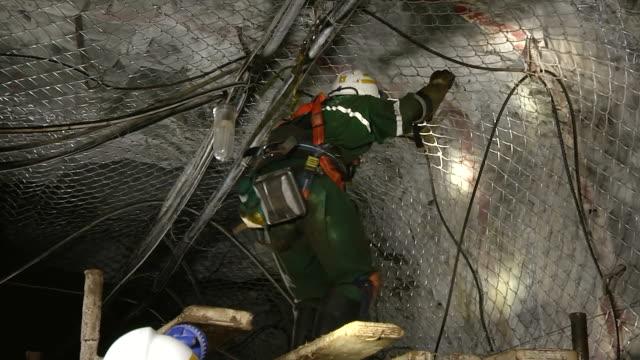 MS TS Shot of Miners working underground / Johannesburg, Gauteng, South Africa
