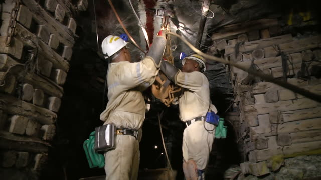 ms la shot of miners working underground / johannesburg, gauteng, south africa - bergbau stock-videos und b-roll-filmmaterial