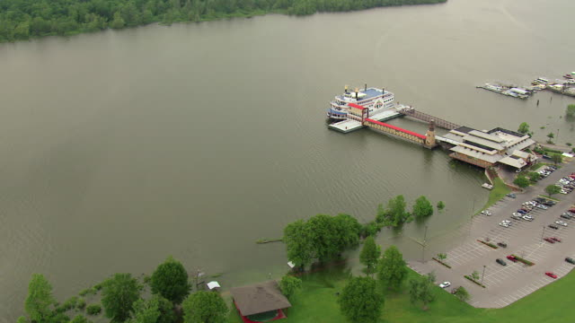 MS AERIAL Shot of Mississippi River and boat sitting at dock / Greenville, Mississippi, United States