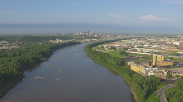 WS AERIAL Shot of Missouri River and downtown in background / Kansas City, Missouri, United States