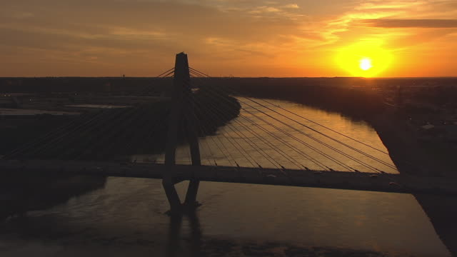 WS AERIAL Shot of Missouri River approaching Christopher S Bond Bridge during sunrise / Kansas City, Missouri, United States