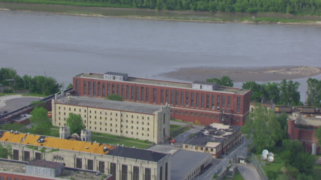 ws aerial shot of missouri state penitentiary and missouri river in background / jefferson city, missouri, united states - missouri stock videos & royalty-free footage