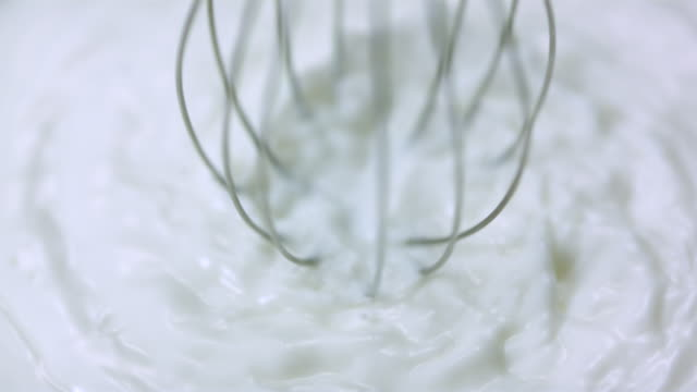 ecu slo mo shot of mixer is rotating in milk / toronto, ontario, canada  - wire whisk stock videos and b-roll footage