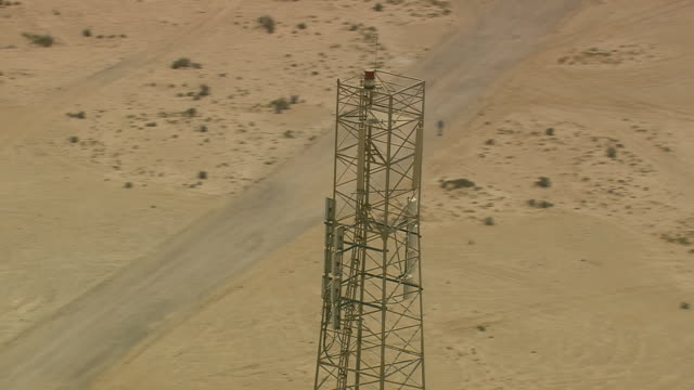 ms aerial ds zi zo shot of mobile tower in desert / qatar - mast stock videos & royalty-free footage