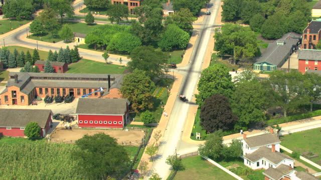 ms aerial shot of  model t driving around greenfield village at henry ford museum / dearborn, michigan, united states - フォード・t型モデル点の映像素材/bロール