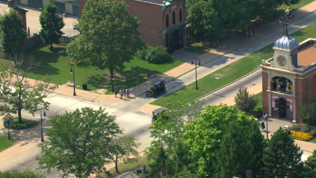 ms aerial shot of  model t in greenfield village at henry ford museum / dearborn, michigan, united states - ford motor company stock videos and b-roll footage