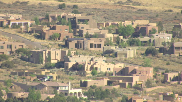 MS AERIAL Shot of modern adobe style houses / Albuquerque, New Mexico, United States