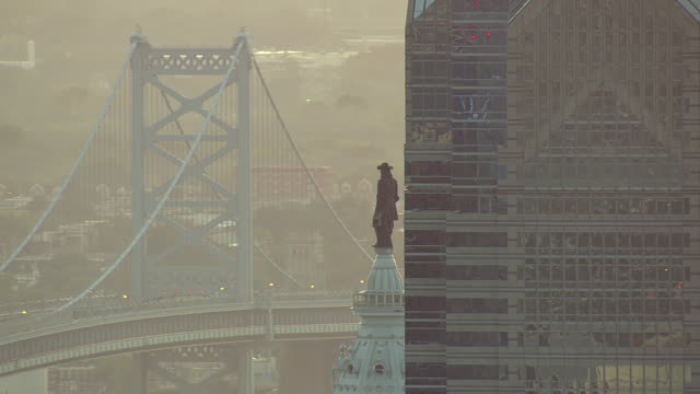 CU AERIAL Shot of modern office buildings and statue of William Penn on top of City Hall / Philadelphia, Pennsylvania, United States