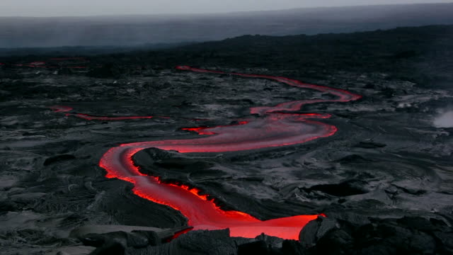MS T/L Shot of molten lava flow going down lava plateau at early morning / Big Island, Hawaii, United States