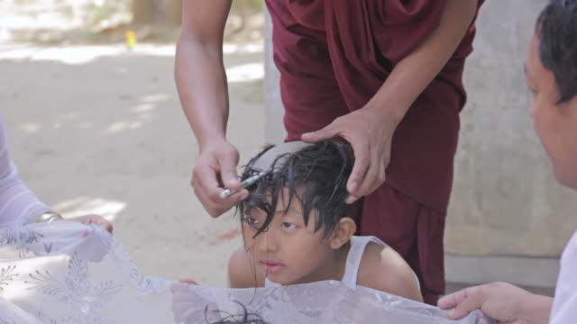 ms td shot of monk shaving a boys head / bagan, mandalay division, myanmar - shaving stock videos & royalty-free footage