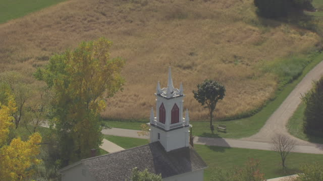 cu aerial shot of moravian church steeple and pull out to reveal heritage hill state historical park and city with fox river / green bay, wisconsin, united states  - steeple stock videos & royalty-free footage