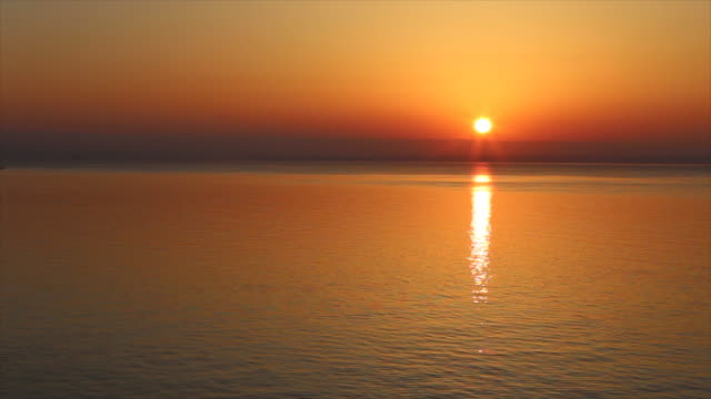 shot of morning light over aegean sea at sun rising - byakkaya stock videos and b-roll footage