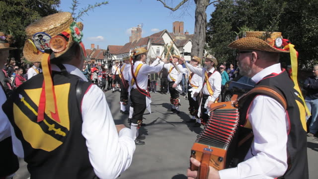 "MS Shot of ""Morrismen"" dancing in street for Shakespeare birthday celebrations AUDIO / Stratford upon Avon, Warwickshire, United Kingdom"