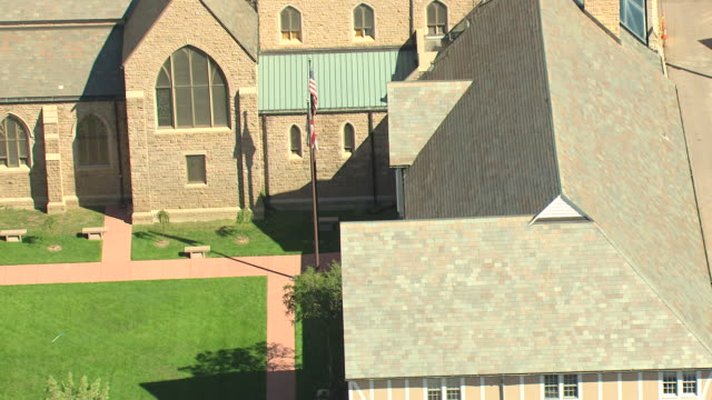 MS DS TU AERIAL Shot of mother and child walking into church and rooftop and gothic tower in daylight / Colorado Springs, Colorado, United States
