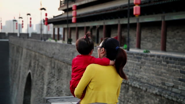 ms shot of mother and daughter talking on xian city wall / xian, china - lantern stock videos & royalty-free footage