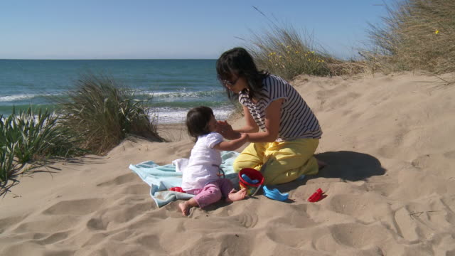 ms shot of mother applying sunscreen to child / marbella, andalusia, spain - sun cream stock videos and b-roll footage