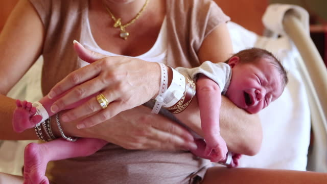 MS Shot of mother burping her newborn baby  / Lamy, New Mexico, United States