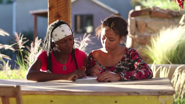 ms pan shot of mother helping her daughter with her homework / lamy, new mexico, united states - lamy new mexico stock videos and b-roll footage