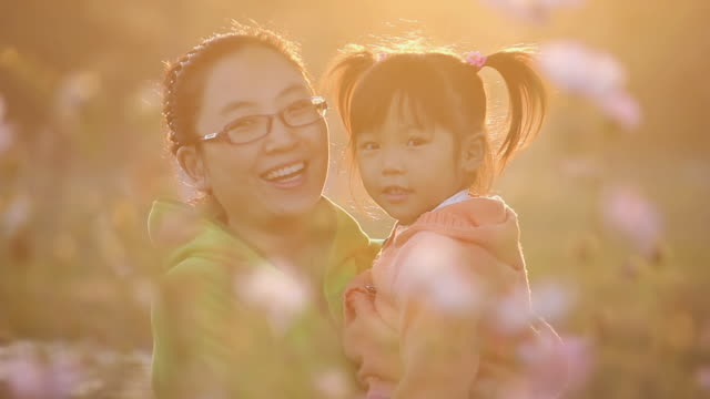 MS Shot of Mother with daughter having fun in garden centre when sunset / Xi'an, Shaanxi, China