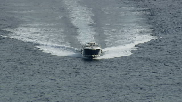 ms aerial ts zo shot of motor boat running on sea surface / monaco, france - speed boat stock videos & royalty-free footage