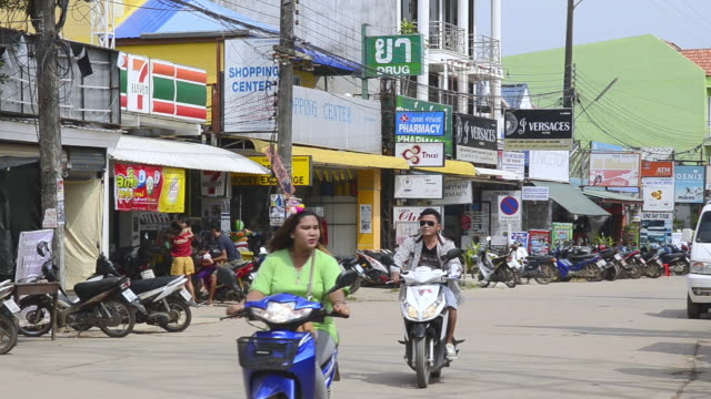 ms shot of motorbike taxis driving in main road in ban saladan / island ko lanta, krabi province, thailand - ko lanta stock videos & royalty-free footage