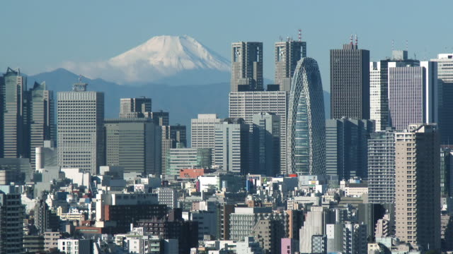 WS Shot of Mount Fuji and Shinjyuku with skyscraper / Tokyo, Japan