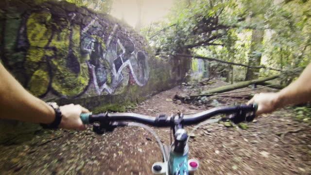 CU POV Shot of mountain bike rider inside Villa Ada park along mountain bike track / Rome, Italy