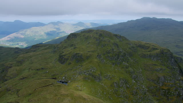 MS AERIAL Shot of mountain tops bare and treeless near western Scotland / Loch Long, Argyll and Bute, Scotland