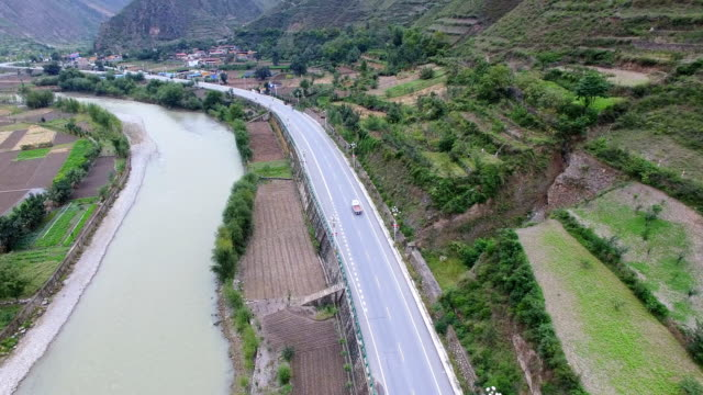aerial shot of mountains and villages/gansu,china - country road stock videos & royalty-free footage