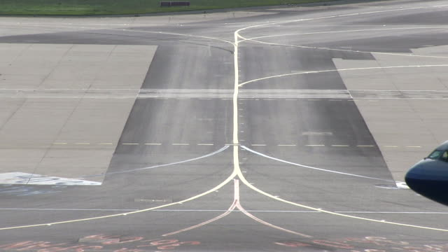 ms shot of moving airplane at taxiway / frankfurt, hesse, germany   - taxiway stock videos & royalty-free footage