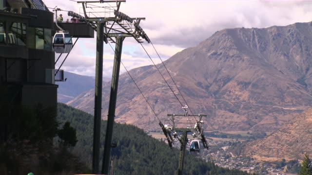 MS Shot of moving Gondola (cable car) at valley / Queenstown, New Zealand