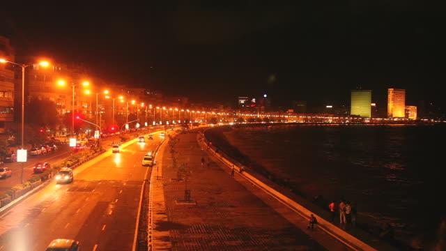 WS ZI T/L Shot of moving traffic at Marine Drive / Mumbai, Maharashtra, India