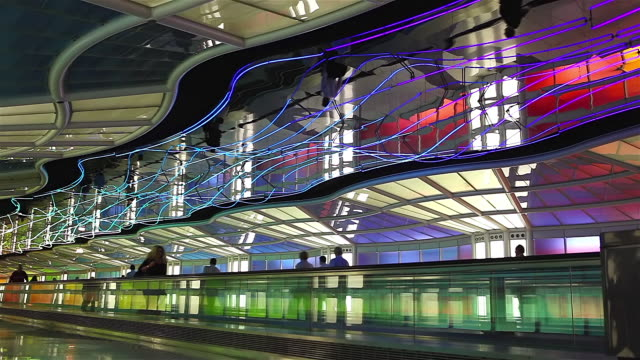 ms shot of moving walkway with colorful roof and light show at o'hare international airport interior / chicago, illinois, united states  - o'hare airport stock videos & royalty-free footage