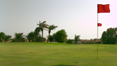 ws slo mo shot of mowing grass on golf corse / elgouna, red sea, egypt - green golf course stock videos & royalty-free footage