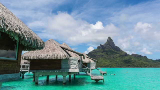 stockvideo's en b-roll-footage met shot of mt otemanu and bungalow - frans polynesië