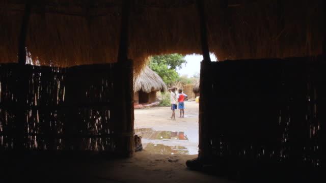 ws shot of mukossanga village from inside shed / lukuzi, eastern, zambia - zambia stock videos & royalty-free footage