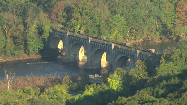 MS AERIAL Shot of multi arched bridge going over Delaware River at Delaware Water Gap / Pennsylvania, United States